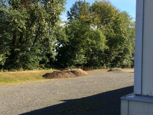 """""""Clean fill"""" soil stored at the Cloverley school site is available for groundskeeping needs throughout the school district. Photographed on July 17, 2015."""