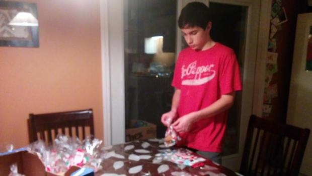 Andrew Teel preparing baked goods for Covenant House