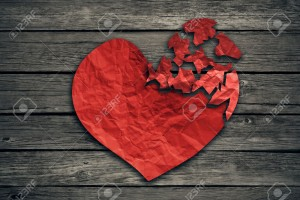 40353077-broken-heart-breakup-concept-separation-and-divorce-icon-red-crumpled-paper-shaped-as-a-torn-love-on-stock-photo