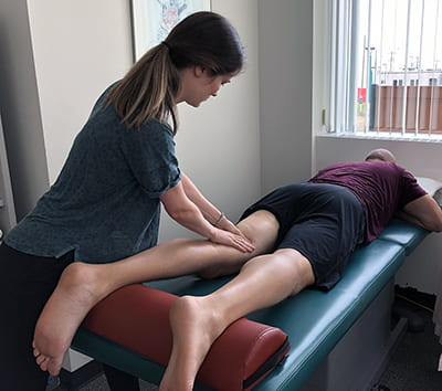 Athletic Therapy Jenn Dunn works on a patient.