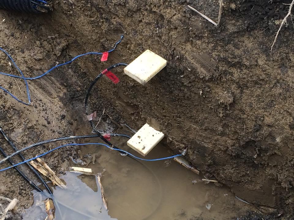 Installing soil moisture sensors in a soil pit