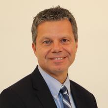 Headshot of Andrew Papadopoulos.