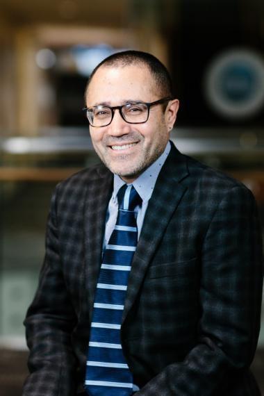 Headshot of Reuben Burga