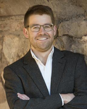 Headshot of Joshua August Skorburg.