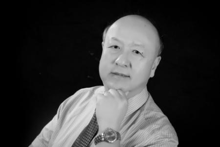 Headshot of Ming Z. Fan