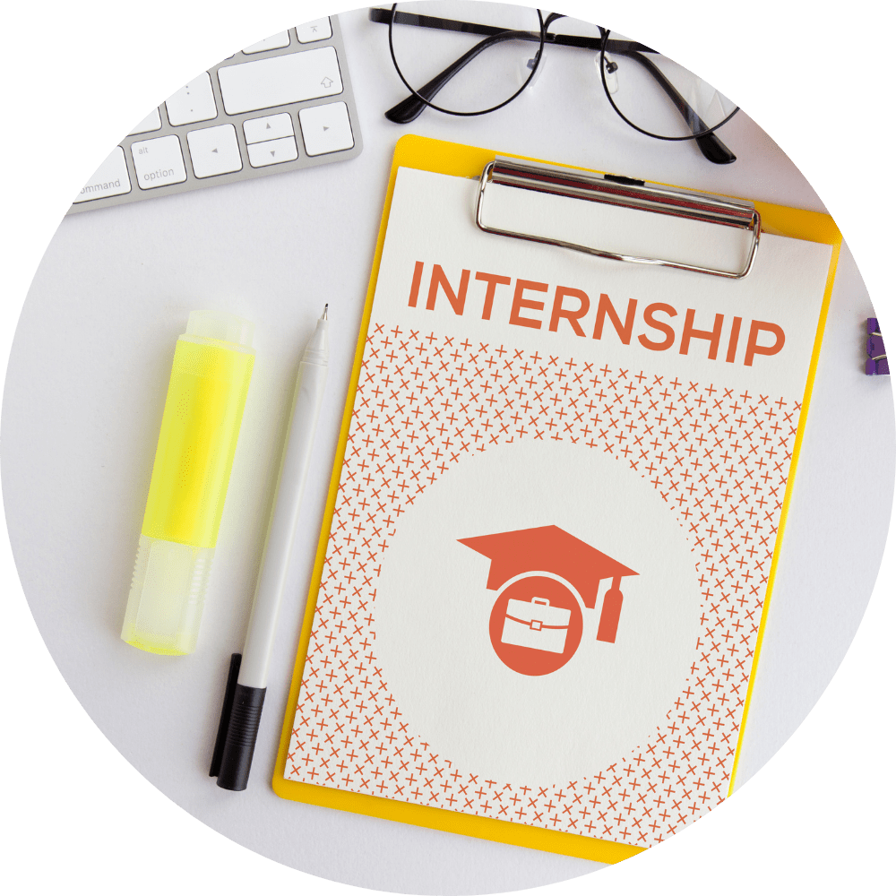 Image of a clipboard that reads Internship and is surrounded by a pen. highlighter and a pair of glasses.