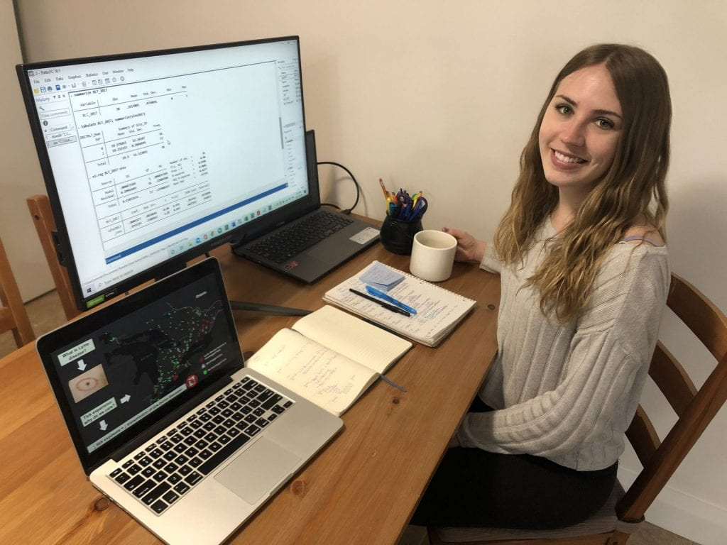 Image of Emily Robinson working at her computer.