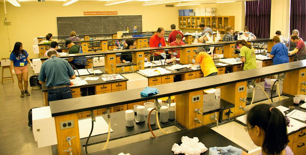 a lab setting with two people working in the lab