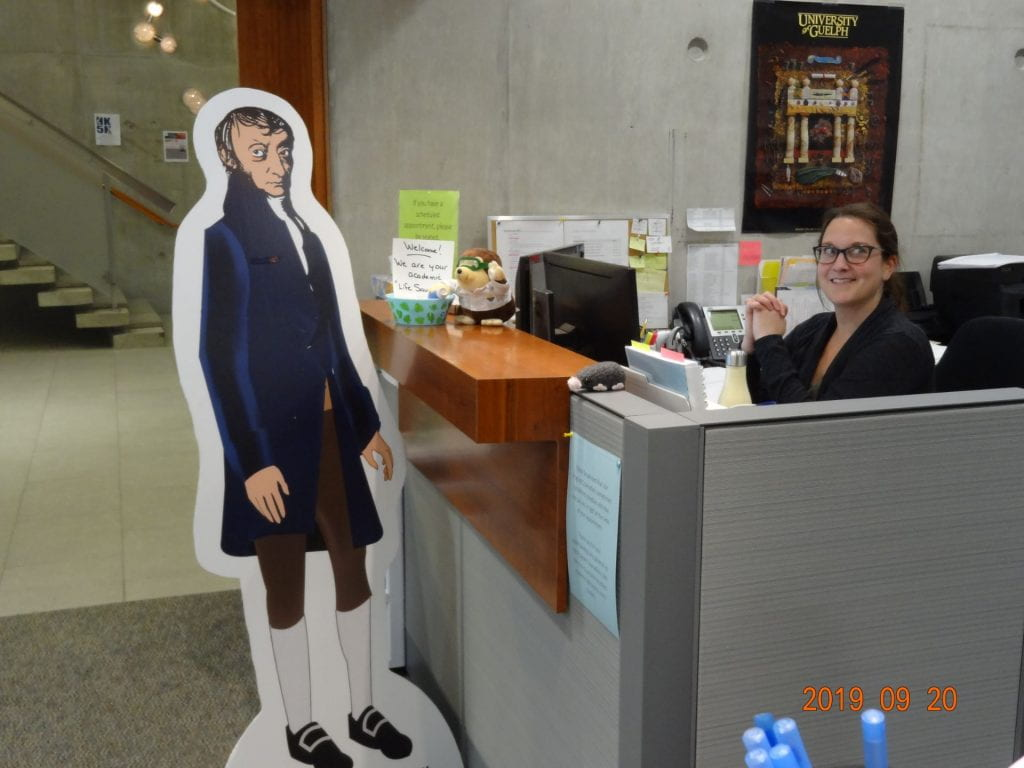 Life-size cut-out Avogadro at the office with undergraduate office with smiling women