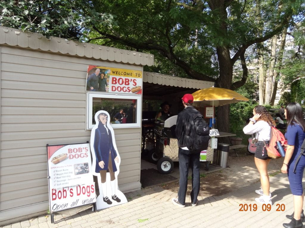 Life-size cut-out of Avogadro in front of a hot dog stand