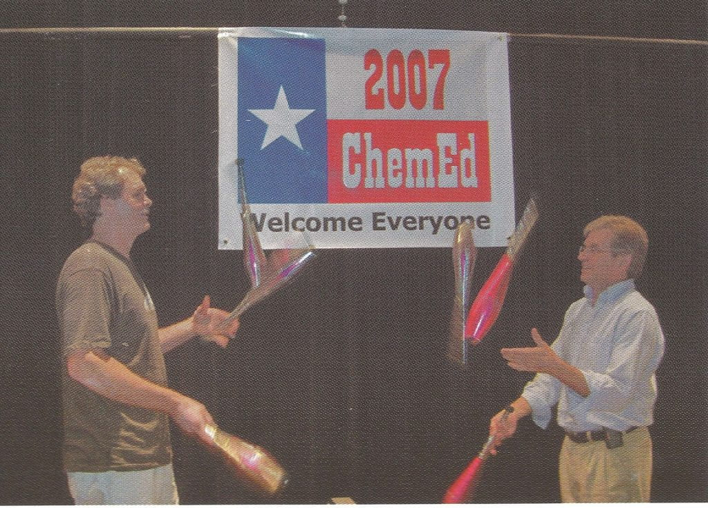 Bill Deese and Rodney Barton juggling in front of a ChemEd 2007 banner