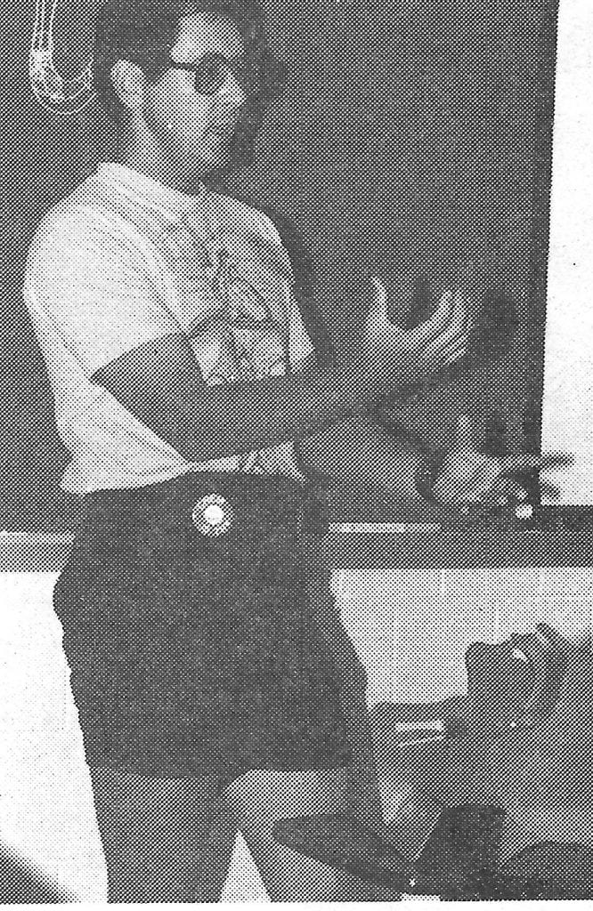Pat Funk at the front of a classroom explaining a concept