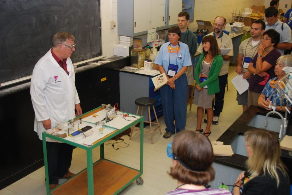 Bob Worley in front of a classroom of teachers and his lab bench